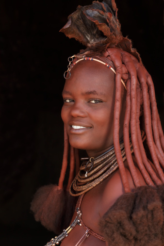 503882077-himba-woman-with-traditional-hair-dress-gettyimages